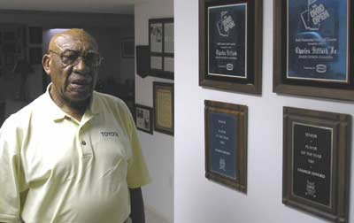 Charlie Sifford at home with some golf awards