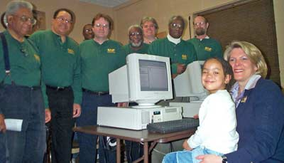 Mayor Jane Campbell with CAP volunteers at a community center PC lab that CAP built