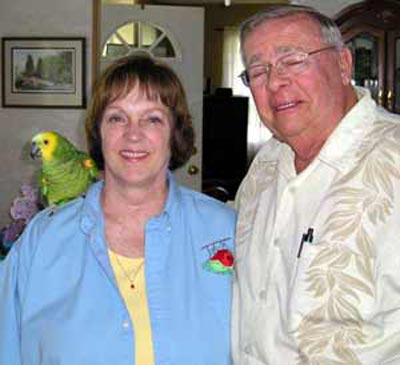 Bonnie and Neil Zurcher with parrot Chico - photo by Debbie Hanson