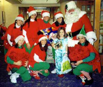 Santa Claus with Girl Elves and a sick child